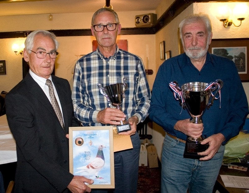 Peter Winter presenting Jim Sexton & Dave McSween with their trophies - McSween & Sexton of Sunderland were highest prizewinners in the Sportsman FC & won Coutances Youngbird race & the Sportsman FC Averages trophy 2018